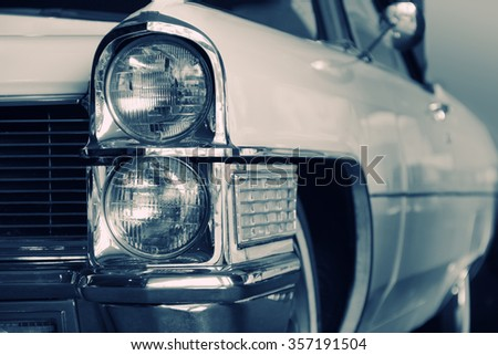 Old fancy car in classical black and white color portrait - stock photo