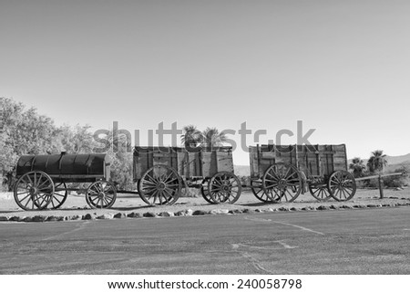 Old Far West Band Wagon in black and white - stock photo