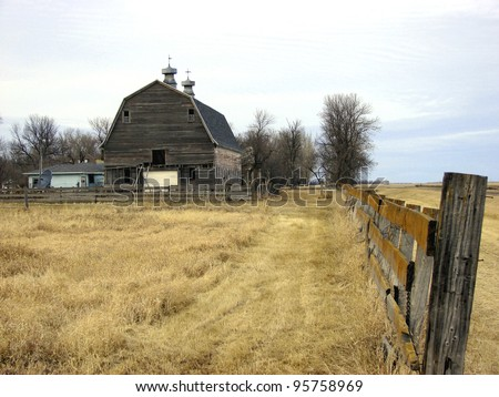 old farm building and wooden fence