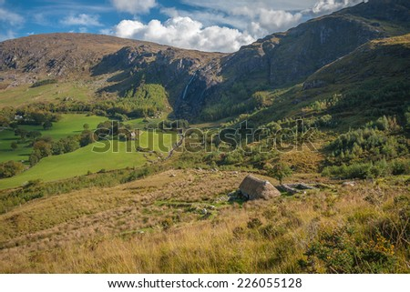 Old Farm Cottage In A Beautiful Valley - stock photo
