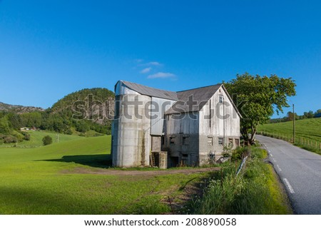 Old farm house and grain silo in Rogaland, Norway - stock photo