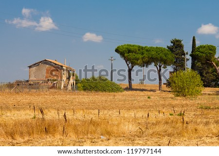 Old Farm House Ruins In Tuscany Placed Next To Cypress
