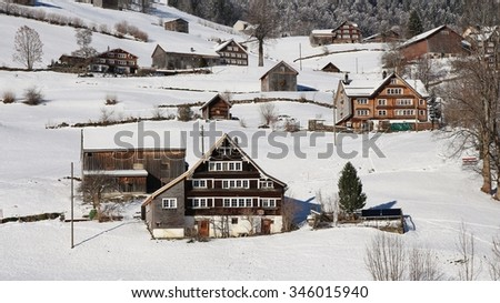 Old farm houses in the Toggenburg valley - stock photo