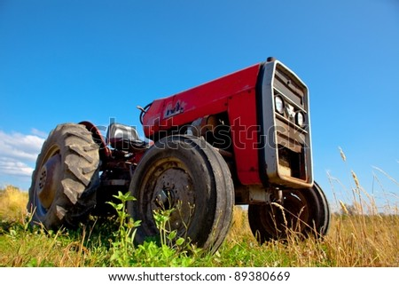 old farm tractor in a field
