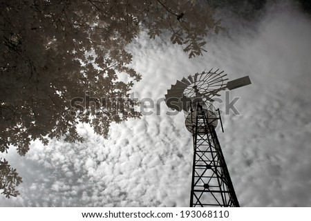Old farm windmill from the north of Portugal. Used infrared filter. - stock photo