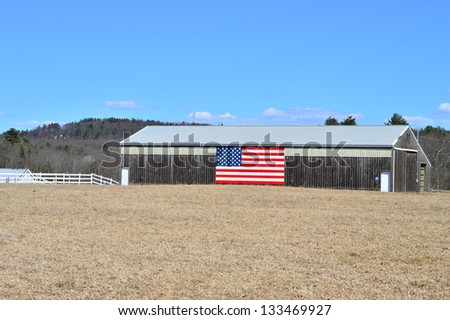 Old farm with an American flag painted on the side