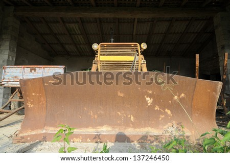 old farm working machine in an abandoned farm in north Italy - stock photo