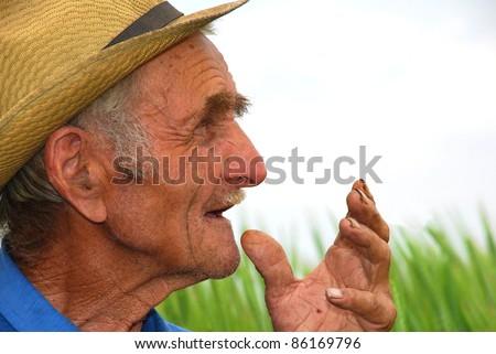 Old farmer - stock photo