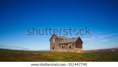 old farmhouse in the prairies, Alberta, Canada - stock photo