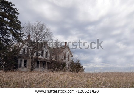 Old Farmhouse with Clouds - stock photo