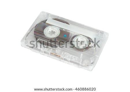 Old-fashiened compact audio cassette of transparent plastic. Isolation on a white background.