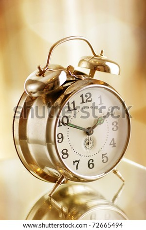 Old fashion alarm clock in warm morning light - stock photo