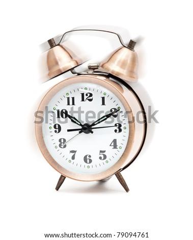 Old-fashion alarm clock ringing, shaking - stock photo