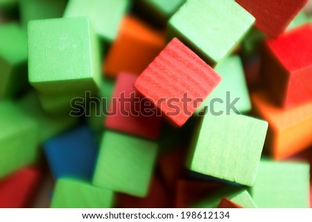 Old fashion children's wooden building blocks in a variety of colors - stock photo