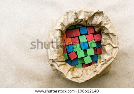 Old fashion children's wooden building blocks in a variety of colors in bag - stock photo