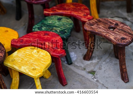 Old fashion colored chairs at rural market in travel destination - stock photo