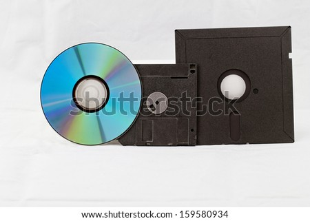 Old Fashion Floppy Disc and Compact Disc ( DVD, CD, CD-RW, DVD-RW ) - stock photo