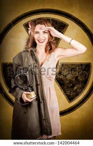 Old-fashion photograph of a military pin-up woman saluting with allied gas mask in front of a nuclear radiation symbol. Atomic female bombshell - stock photo
