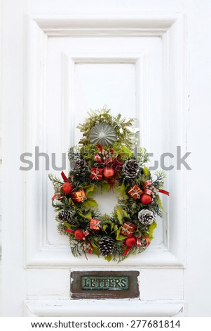 Old fashion style door with christmas wreath - stock photo
