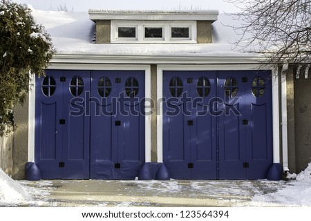 Old fashion two car wooden garage - stock photo