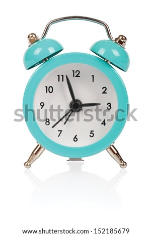 Old fashioned alarm clock on white background