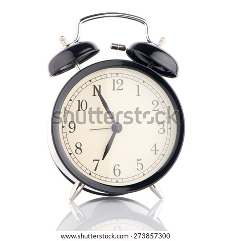 Old fashioned alarm clock on white background. - stock photo