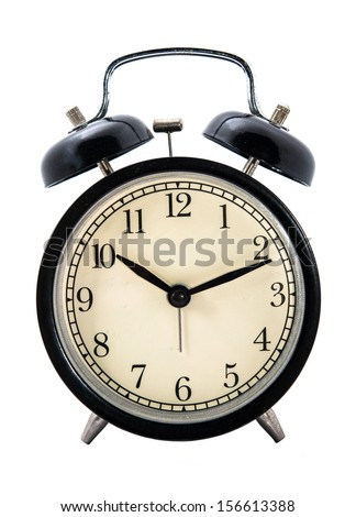 old fashioned alarm clock on white backgrounds - stock photo