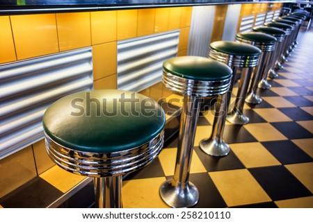 old fashioned bar stools - stock photo