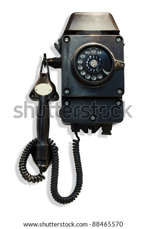Old-fashioned black wall-mounted telephone with rotary dial - stock photo