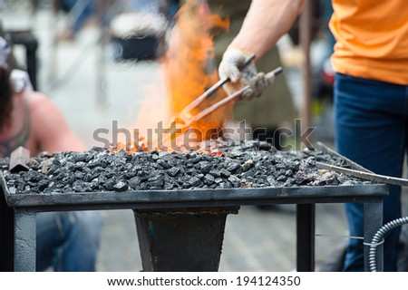 Old fashioned blacksmith furnace with burning coals