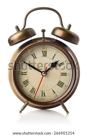 old-fashioned bronze alarm-clock on the white background - stock photo