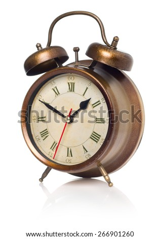 old-fashioned bronze alarm-clock on the white background