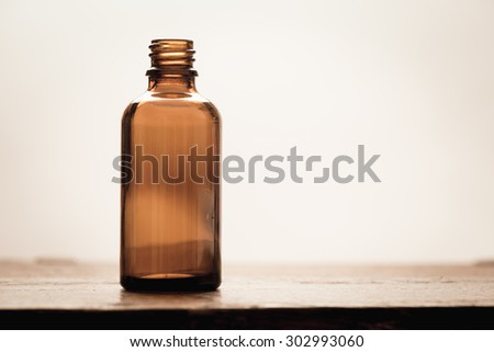 Old fashioned brown glass bottle. Conceptual image of historical clinical testing, scientific analysis and retro science.