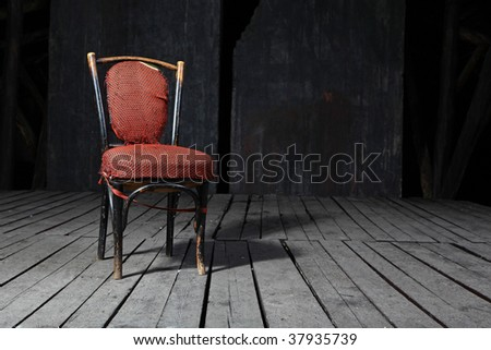 Old fashioned chair on wooden floor