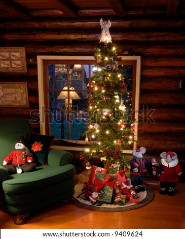 old fashioned christmas tree in log cabin in front of window with stuffed animals in scene