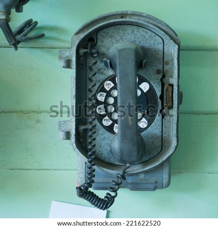 old-fashioned classic vintage telephone on the  wall - stock photo