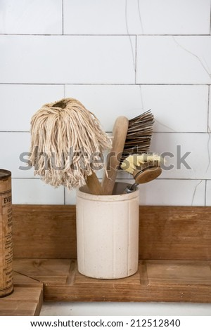 Old fashioned cleaning mop and brushes - stock photo