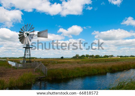 Old fashioned country windmill for pumping water