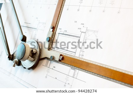 Old-fashioned drawing board with white project blueprint - stock photo
