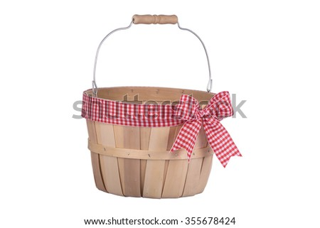 Old fashioned empty wooden basket with plaid ribbon isolated on white background