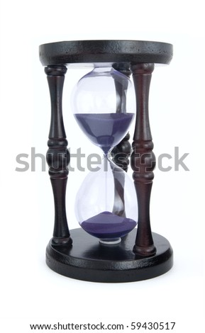 Old-fashioned hourglass isolated on white