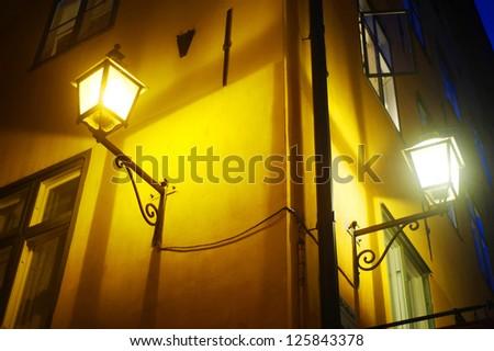 Old fashioned lantern on old Stockholm street ( Gamla Stan ) - stock photo