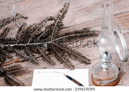 Old fashioned letter with a pen, twig and lamp - stock photo