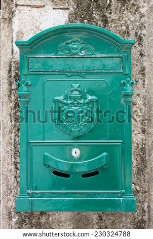 old fashioned mail box on a stone wall  - stock photo