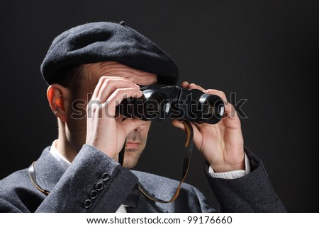 Old fashioned man look through the binoculars