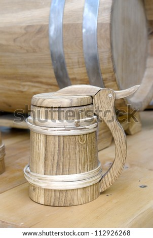 Old-fashioned, medieval wooden mug - stock photo