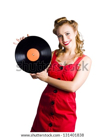 Old fashioned music concept with a smiling woman and an old record - stock photo