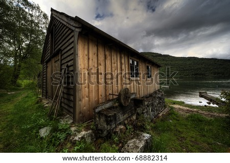 Old-fashioned norwegian fisherman shack - stock photo