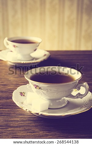Old-fashioned porcelain two cups of tea in vintage style - stock photo