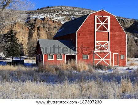 Old fashioned red barn in rural Utah, USA. - stock photo